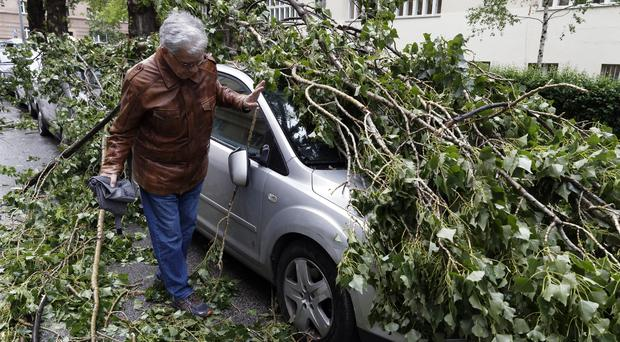 A car was damaged by falling branches in Zagreb, Croatia (Darko Bandic/AP)