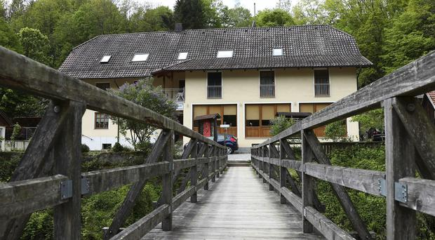 Police are investigating the mysterious death of three people whose bodies were found with crossbow bolts inside a hotel in Bavaria (Matthias Schrader/AP)