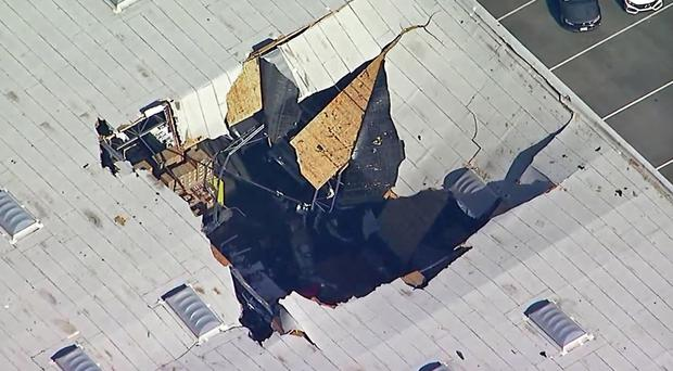 The F-16 fighter jet crashed into a warehouse (KABC-TV/AP)