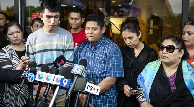 Marlen Ochoa-Lopez's family talk to reporters (Ashlee Rezin/Chicago Sun-Times via AP)