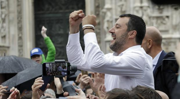 Supporters reach out to Matteo Salvini during the rally (Luca Bruno/AP)