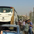 A bus and car after being damaged by a bomb, in Cairo, Egypt (Mohammed Salah/AP)