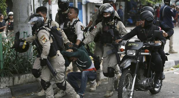 Indonesian police arrest a supporter of the losing presidential candidate in Jakarta (AP Photo/Achmad Ibrahim)