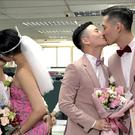 Two same-sex couples seal their legal marriage with a kiss in Taipei, Taiwan (Johnson Lai/AP)