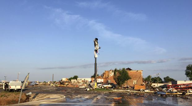 Debris lies on the ground at a hotel after a deadly storm moved though a town in Oklahoma (Tim Talley/AP)