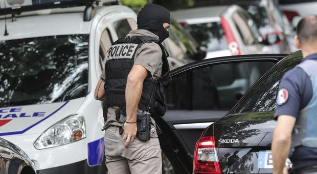 Police search a suspect's home following a blast in Lyon (Laurent Cipriani/AP)