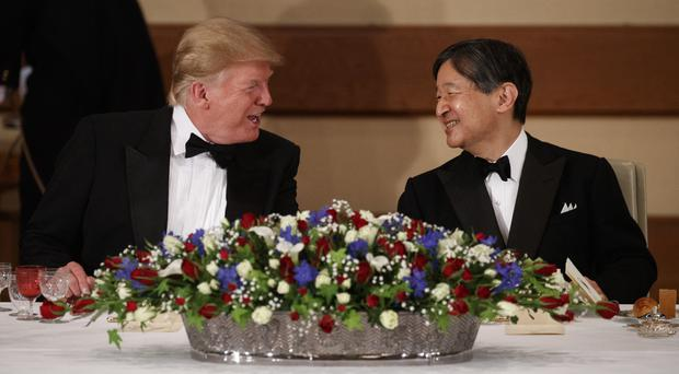 President Donald Trump talks with Japanese Emperor Naruhito during a State Banquet (Evan Vucci/AP)