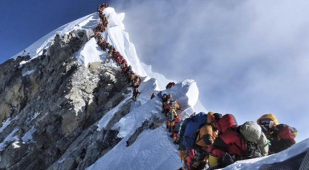 A long queue of mountain climbers line a path on Mount Everest (Nimsdai Project Possible via AP)