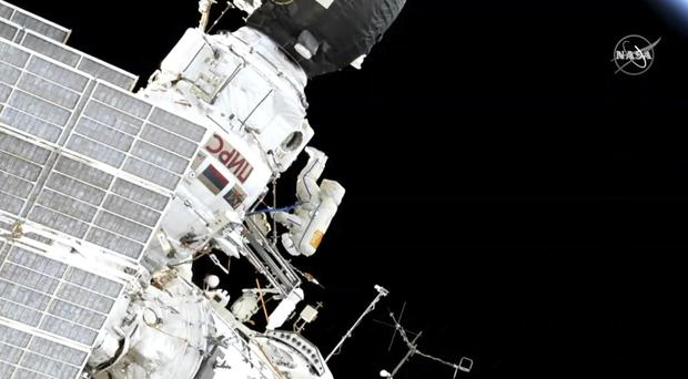 Oleg Kononenko and Alexey Ovchinin participate in a spacewalk outside the International Space Station (NASA via AP)