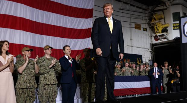 President Donald Trump onboard the USS Wasp in Yokosuka, Japan (Evan Vucci/AP)
