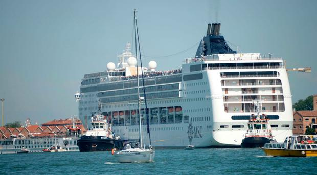 The MSC Opera after the collision with a tourist boat in port of Venice