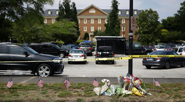 A makeshift memorial rests at the edge of a police cordon in front of a municipal building that was the scene of a shooting in Virginia Beach (Patrick Semansky/AP)