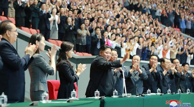 North Korean leader Kim Jong Un, centre, waves with his wife Ri Sol Ju, centre left, during the grand gymnastics and artistic performance at the May Day Stadium in Pyongyang. The woman next to Ri Sol Ju appears to be Kim's sister, Kim Yo Jong, (Korean Central News Agency/Korea News Service via AP)