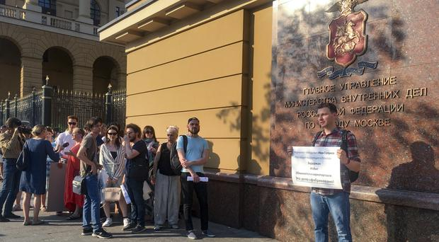 Protests are held outside the Russian internal ministry building in Moscow for detained journalist Ivan Golunov (AP)