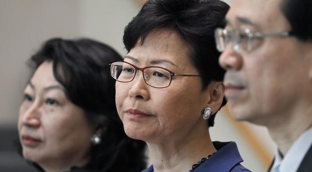 Carrie Lam, middle, said the legislation is important and will help Hong Kong uphold justice and fulfil its international obligations (AP/Vincent Yu)