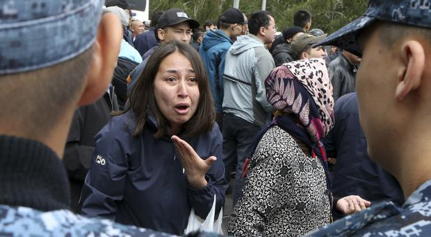 A woman speaks to Kazakh police as they block demonstrators during an anti-government protest during the presidential elections in Nur-Sultan, the capital city of Kazakhstan (AP Photo/Alexei Filippov)