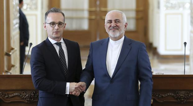 Iranian foreign minister Mohammad Javad Zarif, right, and his German counterpart Heiko Maas (Ebrahim Noroozi/AP)