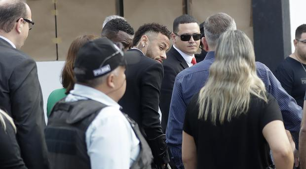 Brazilian star Neymar arrives at a police station (Andre Penner/AP)