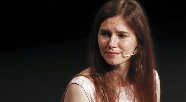 Amanda Knox attends a Criminal Justice Festival at the University of Modena (Antonio Calanni/AP)
