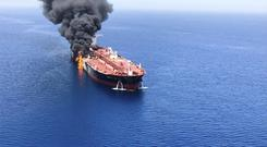 An oil tanker on fire in the Sea of Oman (ISNA/AP)