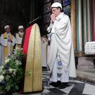 The Archbishop of Paris Michel Aupetit leads the first mass in a side chapel, two months after a devastating fire engulfed the Notre-Dame de Paris cathedral (Karine Perret/AP)