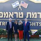 Israeli prime minister Benjamin Netanyahu, right, his wife Sara, centre right, United States Ambassador to Israel David Friedman, left, and his wife Tammy pose during the inauguration of the new settlement (Ariel Schalit/AP)