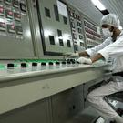 An Iranian technician working in 2007 at the Uranium Conversion Facility just outside the city of Isfahan (Vahid Salemi/AP)