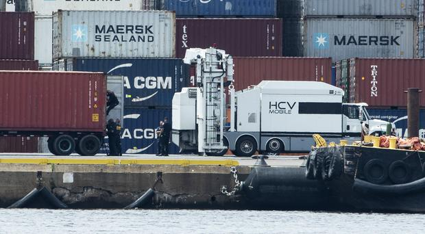 Authorities search a container along the Delaware River in Philadelphia (Matt Rourke/AP)