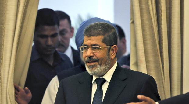 File photo of former Egyptian President Mohammed Morsi who died this week (Manish Swarup/AP)