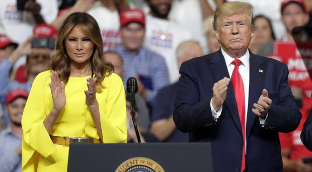 First lady Melania Trump and President Donald Trump greet supporters at a rally to formally announce his 2020 re-election bid in Orlando (John Raoux/AP)