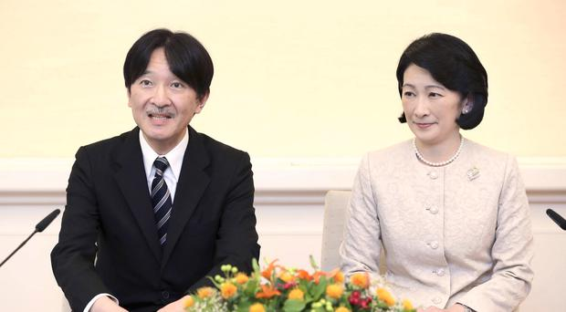 Japan's Crown Prince Akishino, accompanied by his wife Crown Princess Kiko, speaks during a press conference ahead of his trip to Finland and Poland (Kyodo/AP)