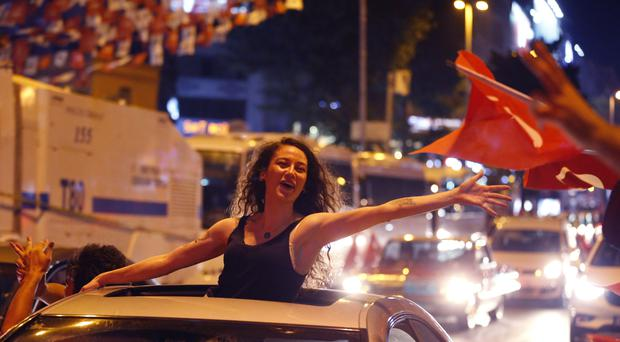Supporters of Ekrem Imamoglu, the candidate of the secular opposition Republican People's Party, CHP, celebrate in central Istanbul (Lefteris Pitarakis/AP)