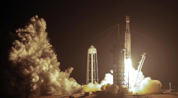 A SpaceX rocket lifts off from the Kennedy Space Centre (John Raoux/AP)