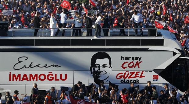 Ekrem Imamoglu, the new mayor of Istanbul, makes a speech from a bus after taking office (Lefteris Pitarakis/AP)