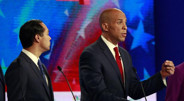 Cory Booker gestures as Julian Castro listens (Wilfredo Lee/AP)