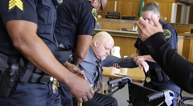 William Talbott II is helped to a wheelchair by Snohomish County Sheriff's Deputies after being found guilty (Kevin Clark/AP)