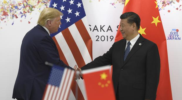 Donald Trump shakes hands with Chinese President Xi Jinping (Susan Walsh/AP)