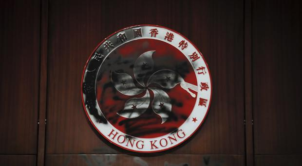 A defaced Hong Kong emblem after protesters broke into the Legislative Council building (AP Photo/Kin Cheung)