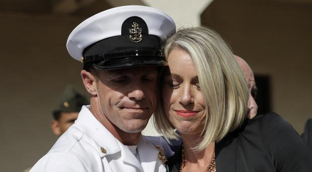 Navy Special Operations Chief Edward Gallagher and his wife hug after leaving a military court in San Diego (Gregory Bull/AP)