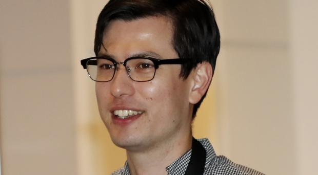 Australian student Alek Sigley arrives at Tokyo airport after his release by North Korea (Eugene Hoshiko/AP)