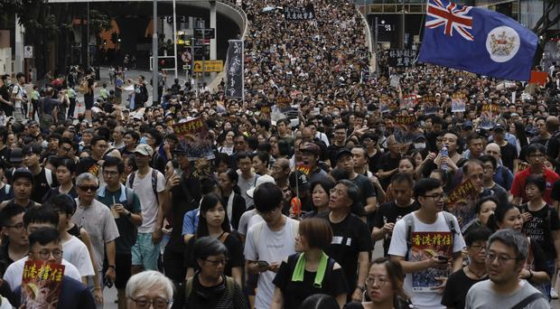 Protesters march in Hong Kong (AP Photo/Vincent Yu)