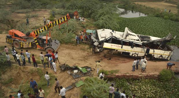 A crane recovers a damaged in Agra, India (Pawan Sharma/AP)