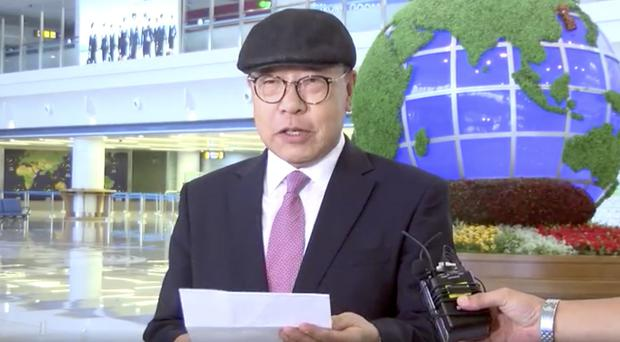 Choe In-guk giving a statement to media as he arrived in the North to permanently resettle (Uriminzokkiri via AP)