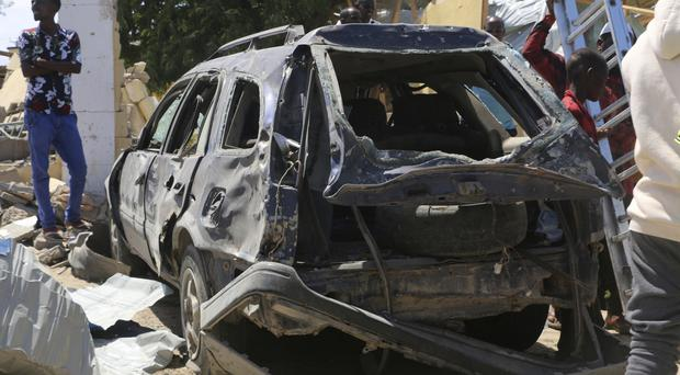 A car destroyed during an attack at the Asasey Hotel in Kismayo, Somalia (AP)