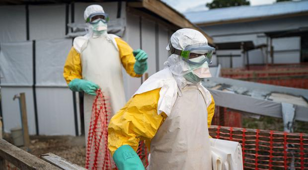 Health workers wearing protective suits take their shift at a treatment centre in Beni, DR Congo (Jerome Delay/AP)