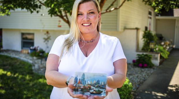 Kim Draper received a postcard at her home in Springfield on July 8, 2019 (Justin L. Fowler/The State Journal-Register via AP)