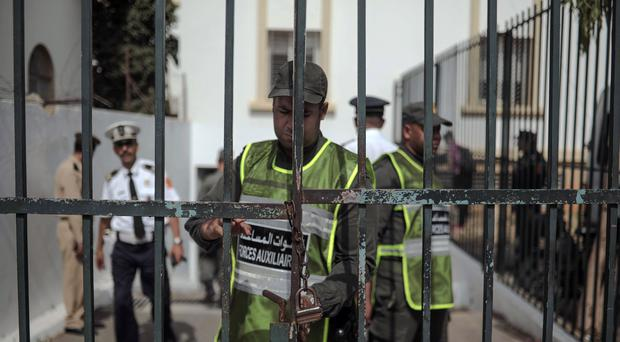Security forces stand guard as the suspects arrive in court (Mosa'ab Elshamy/AP)