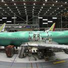 Boeing is scheduled to report its quarterly results next week (Ted S Warren/AP)