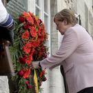 A wreath fixed under a remembrance plaque marking the place where several leaders of the failed assassinate to Adolf Hitler on July 20, 1944 was shoot dead (Markus Schreiber/AP)