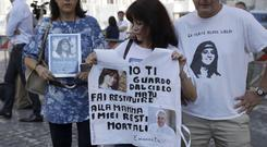 A friend of the Orlandi family holds a T-shirt with pictures of Emanuela Orlandi and Pope Francis (Gregorio Borgia/AP)